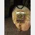 Zen prayer pendant of mixed metals with word wisdom inside