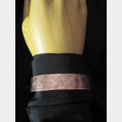 Antiqued copper cuff bracelet engraved with leaf design