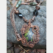 Green and Black Epidote Cabochon copper wire weave pendant with onyx and viking