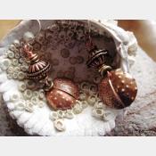 Copper fold form tribal dangle earring
