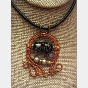 Mixed metal wire woven lampwork organic swirling pendant